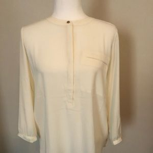 Soft long sleeve light weight cream blouse